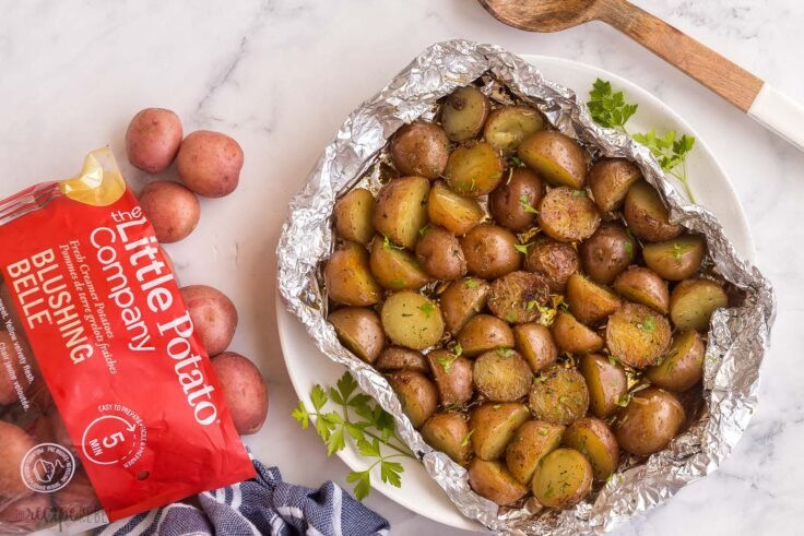 overhead image of grilled potatoes with bag of Little potatoes