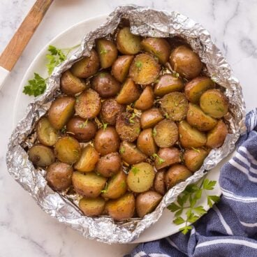 overhead image of grilled potatoes in foil