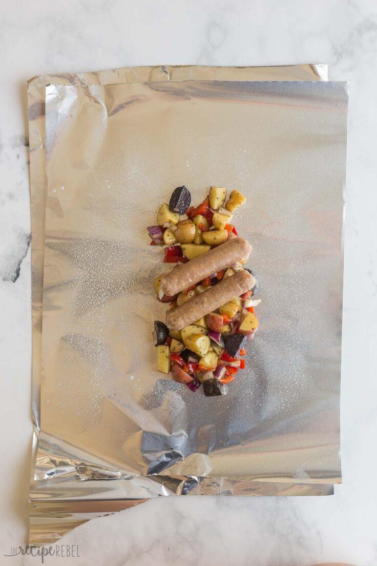 foil pack vegetables and breakfast sausage on foil