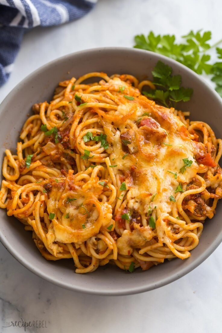 close up image of baked spaghetti in bowl