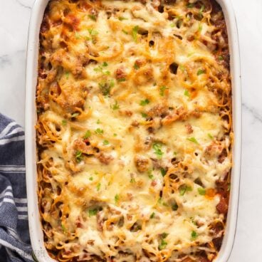 square image of baked spaghetti in baking dish