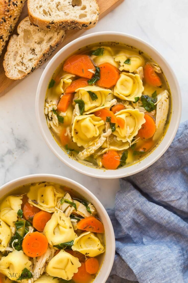 overhead image of two bowls of tortellini soup