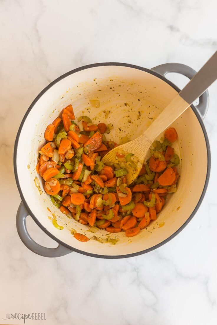 cooked vegetables in pot with spices added