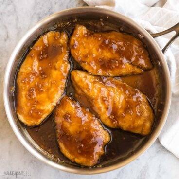 square image of honey garlic chicken breasts in steel pan