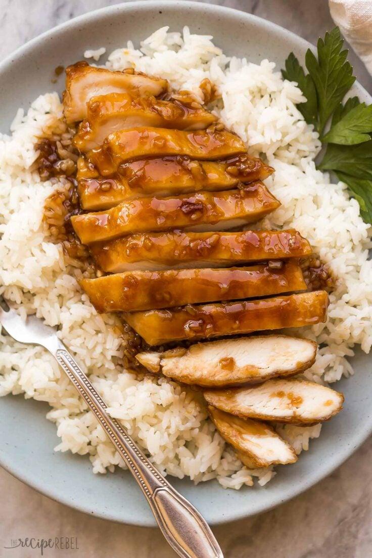 sliced honey garlic chicken breast on a bed of rice