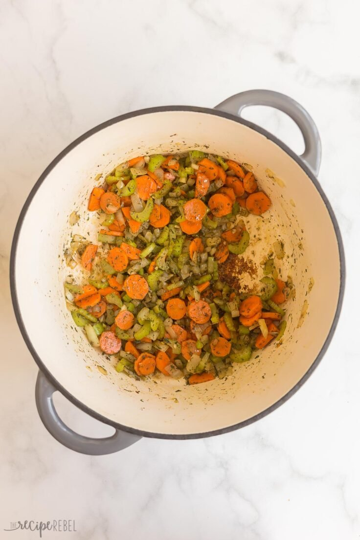 add spices to vegetables and cook in pot