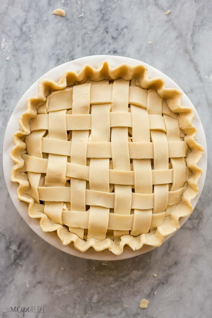 uncooked apple pie with lattice crust ready to bake