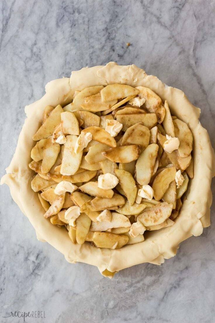 apples in bottom pie crust dotted with butter